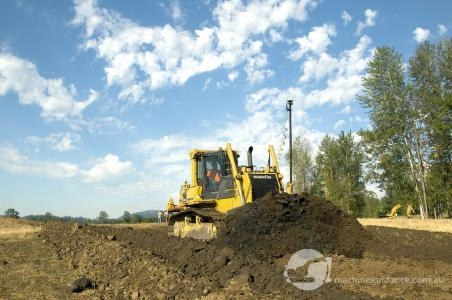 Komatsu 65PX dozer with machine guidance