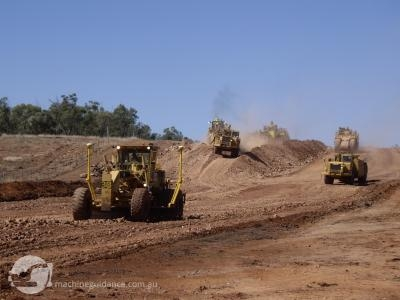 GPS Grader takes control of the scraper operation.