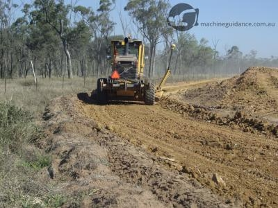 Machine guided construction using a GPS grader rather than survey stakes.