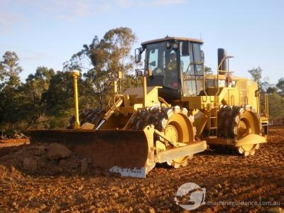 CAT 825 Compactor placing fill with the aid of GPS.
