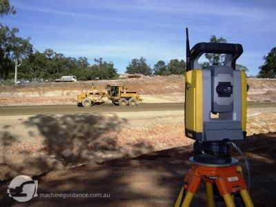 Total station guidance is perfect for trimming gravel pavements.