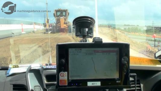 Windscreen-mounted displays show cut/fill levels and design features.
