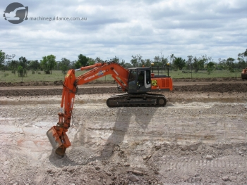 GPS Excavator Trimming Rock