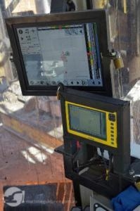Machine guidance displays mounted inside drill rig.
